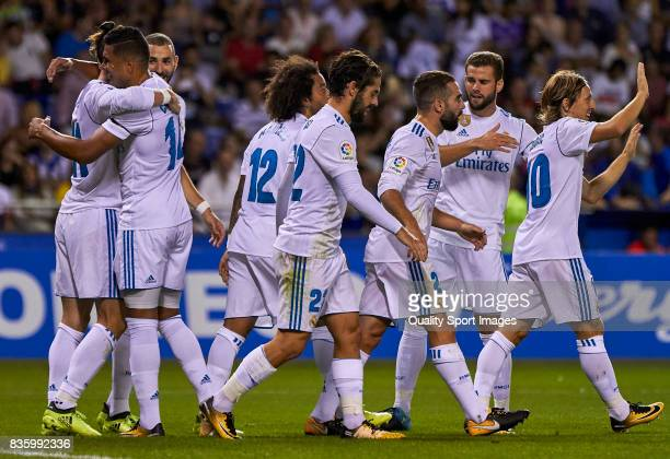 Players of Real Madrid celebrate after scoring the opening goal during the La Liga match between Deportivo La Coruna and Real Madrid at Riazor...
