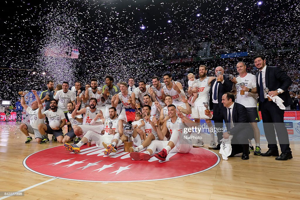 players of Real Madrid celebrate their victory over the 201516 ACB League FC Barcelona in the Barclaycard Center in Madrid Spain on June 22 2016