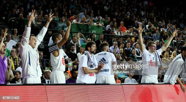 Players of Real Madrid celebrate victory during the 2016/2017 Turkish Airlines EuroLeague Playoffs leg 3 game between Darussafaka Dogus Istanbul v...