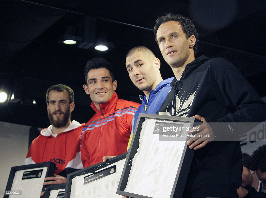 Players of Real Madrid CF and Ral Madrid Basketball (L-R) <a gi-track='captionPersonalityLinkClicked' href=/galleries/search?phrase=Sergio+Rodriguez&family=editorial&specificpeople=765161 ng-click='$event.stopPropagation()'>Sergio Rodriguez</a>, Antonio Adan, <a gi-track='captionPersonalityLinkClicked' href=/galleries/search?phrase=Karim+Benzema&family=editorial&specificpeople=796089 ng-click='$event.stopPropagation()'>Karim Benzema</a> and <a gi-track='captionPersonalityLinkClicked' href=/galleries/search?phrase=Ricardo+Carvalho&family=editorial&specificpeople=209354 ng-click='$event.stopPropagation()'>Ricardo Carvalho</a> attend the opening of the new 'Adidas' store at the Santiago Bernabeu stadium on February 21, 2013 in Madrid, Spain.
