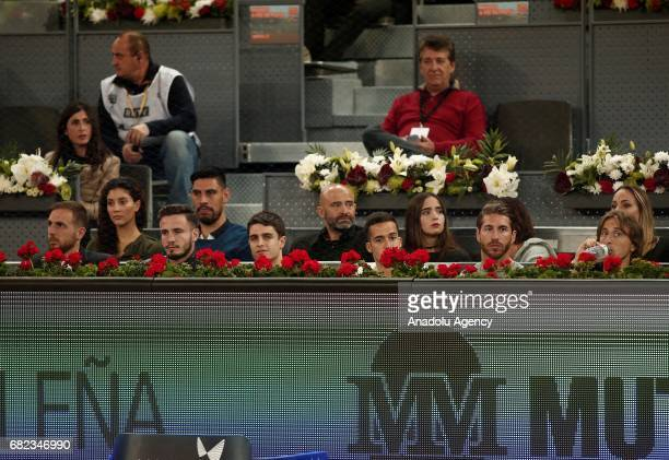 Players of Real Madrid football team Sergio Ramos Luka Modrid Lucas Vazquez and players of Atletico Madrid Jan Oblak and Saul Niguez watch the ATP...