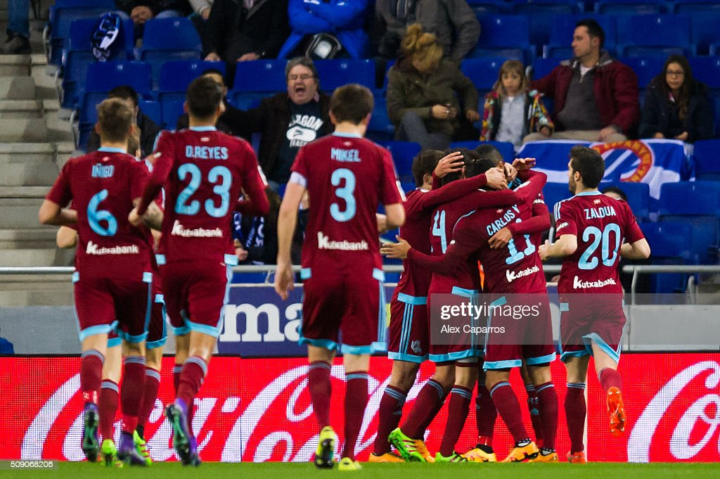 Players of Real Sociedad de Futbol celebrate after their teammate Carlos Vela scored his team's second goal during the La Liga match between RCD Espanyol and Real Sociedad de Futbol at Cornella-El Prat Stadium on February 8, 2016 in Barcelona, Spain.