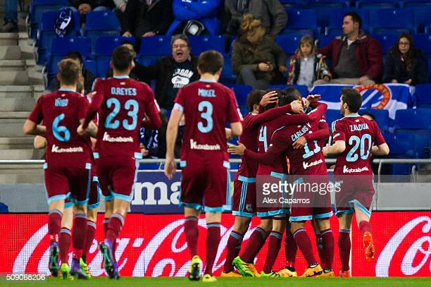 Players of Real Sociedad de Futbol celebrate after their teammate Carlos Vela scored his team's second goal during the La Liga match between RCD...
