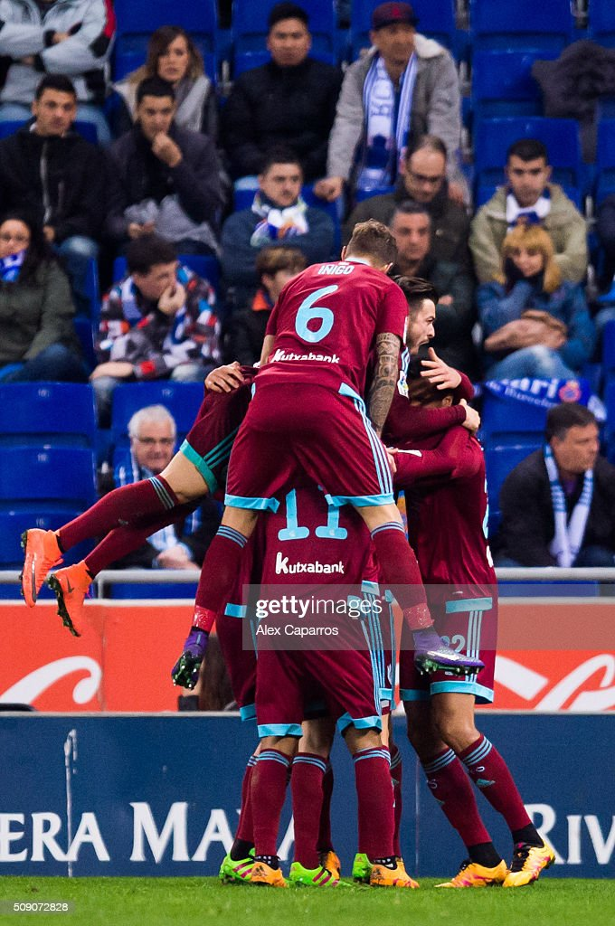 Players of Real Sociedad de Futbol celebrate after their teammate Mikel Oyarzabal scored his team's third goal during the La Liga match between RCD Espanyol and Real Sociedad de Futbol at Cornella-El Prat Stadium on February 8, 2016 in Barcelona, Spain.