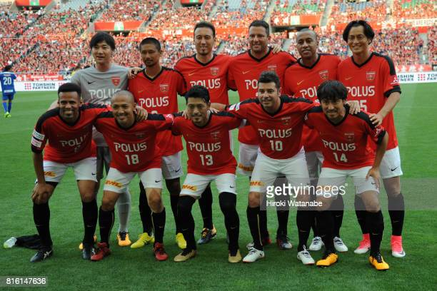 Players of Reds Legends pose for photograph prior to the Keita Suzuki testimonial match between Reds Legends and Blue Friends at Saitama Stadium on...