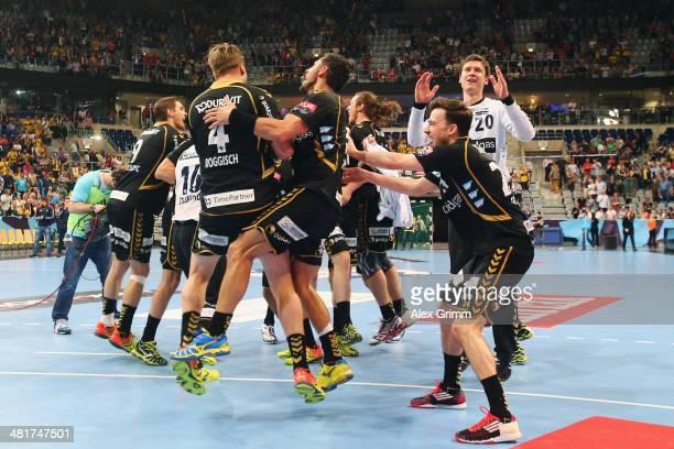 Players of RheinNeckar Loewen celebrate after the Velux EHF Champions League Round of 16 second leg match between RheinNeckar Loewen and KS Vieve...