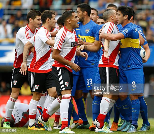 Players of River Plate and Boca Juniors scuffle during a match between Boca Juniors and River Plate as part of Torneo Transicion 2016 at Alberto J...