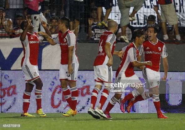 Players of River Plate celebrate a goal during a match between Quilmes and River Plate as part of the Torneo Inicial 2013 at Jose Luis Meiszner...