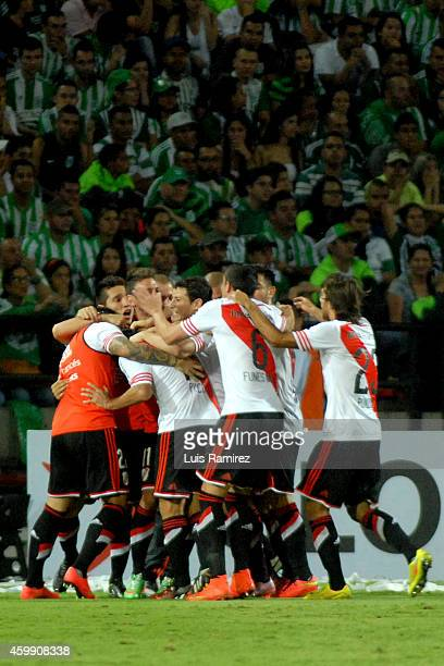 Players of River Plate celebrate a scored goal by Leonardo Pisculichi against Atletico Nacional during a first leg final match between Atletico...
