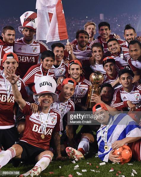 Players of River Plate celebrate with the trophy after winning the Recopa Sudamericana 2016 during a second leg match between River Plate and...