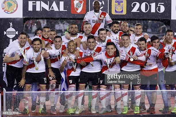 Players of River Plate celebrate with their medals after winning a second leg final match between River Plate and Tigres UANL as part of Copa...