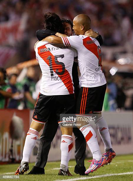 Players of River Plate hug their coach Marcelo Gallardo to celebrate the first goal of his team scored by Leonardo Pisculichi during a second leg...