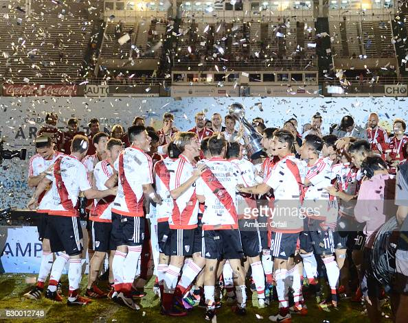 Players of River Plate lift the trophy after a final match between River Plate and Rosario Central as part of Copa Argentina 2016 at Mario Alberto...