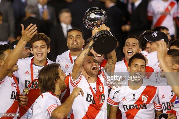 Players of River Plate lift the trophy after wining the second leg final match between River Plate and Atletico Nacional as part of Copa Total...