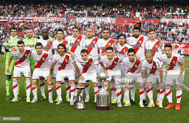 Players of River Plate pose for a photo with Copa Bridgestone Libertadores 2015 trophy and Suruga Bank 2015 trophy prior to a match between River...