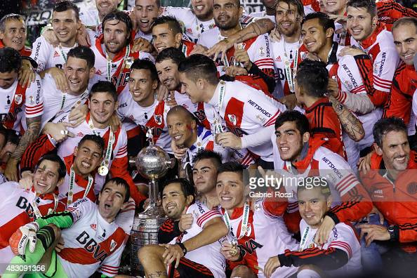 Players of River Plate pose for a team photo with the trophy after winning a final match between River Plate and Tigres UANL as part of Copa...