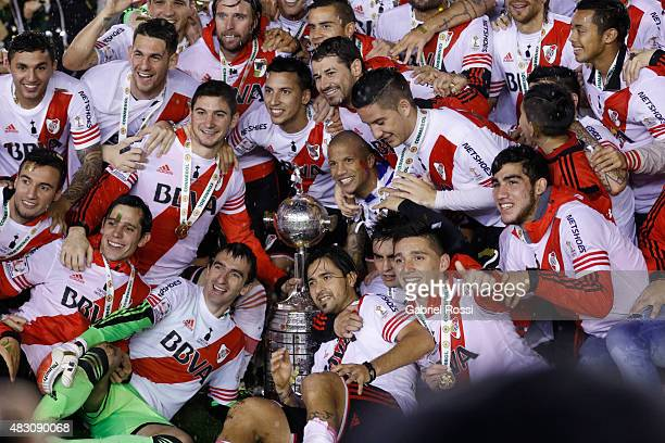 Players of River Plate pose for a team photo with their trophy after winning a final match between River Plate and Tigres UANL as part of Copa...
