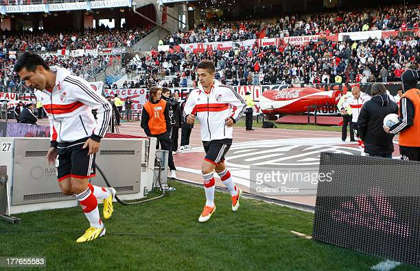 Players of River Plate walk into the field before a match between River Plate and Colon de Santa Fe as part of the Torneo Inicial 2013 at Monumental...