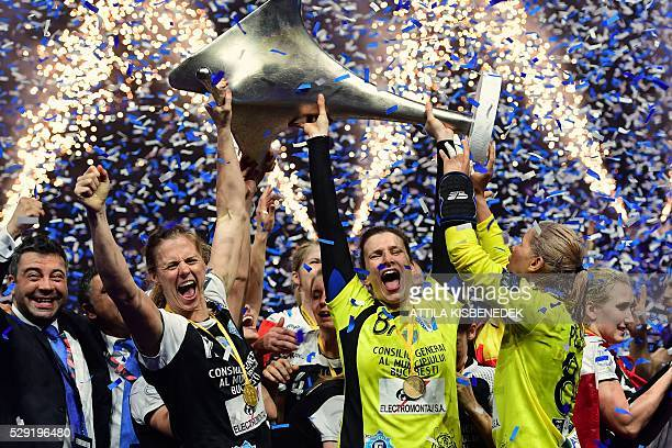 TOPSHOT Players of Romanian GSM Bucharest celebrate with the trophy after winning the EHF Women's Champions League Final Four final match between CSM...