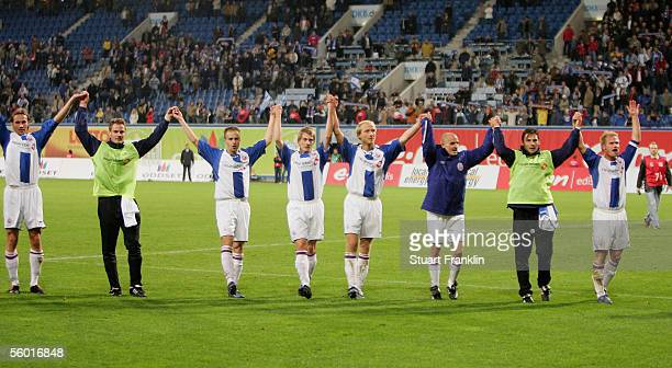 Players of Rostock celebrate at the end the DFB German Cup second round match between Hansa Rostock and VfB Stuttgart at the Ostsee Stadium on...