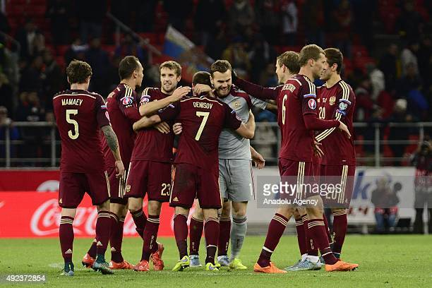 Players of Russia celebrate after the UEFA Euro 2016 qualifying round Group G football match between Russia and Montenegro at Otkritie stadium in...