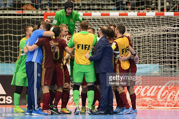Players of Russia celebrate after winning a semi final match between Iran and Russia as part of 2016 FIFA Futsal World Cup Colombia at Coliseo Ivan...