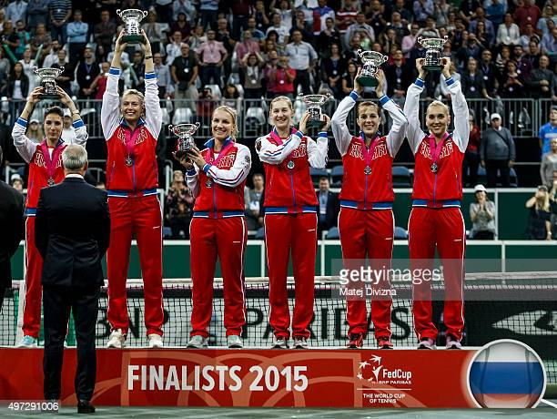 Players of Russia stand on the podium as they celebrate their second place after the Fed Cup final match between Czech Republic and Russia at O2...