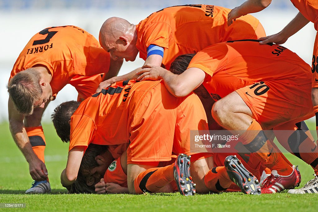 Players of Saarbruecken celebrate their teams second goal during the Third League match between Arminia Bielefeld and 1. FC Saarbruecken at the Schueco Arena on September 17, 2011 in Bielefeld, Germany.