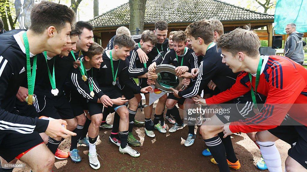 Players of Sachsen celebrate winning the U16 Juniors Federal Cup at Sportschule Wedau on May 03, 2016 in Duisburg, North Rhine-Westphalia.