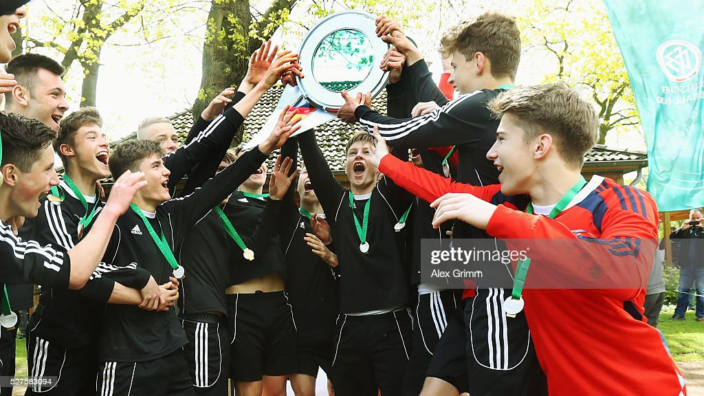 Players of Sachsen celebrate winning the U16 Juniors Federal Cup at Sportschule Wedau on May 03, 2016 in Duisburg, North Rhine-Westphalia.