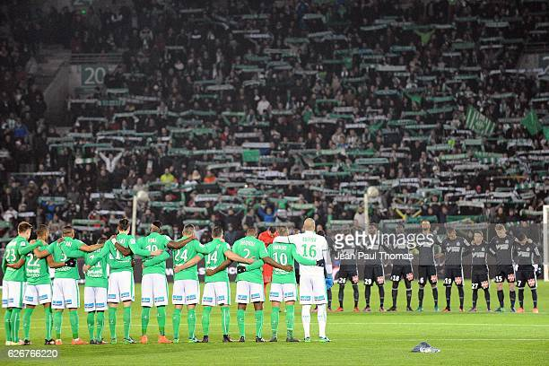 Players of Saint Etienne and Marseille during a minute of silence in memory of the Brazilian football team Chapecoense who has crashed in a plane in...