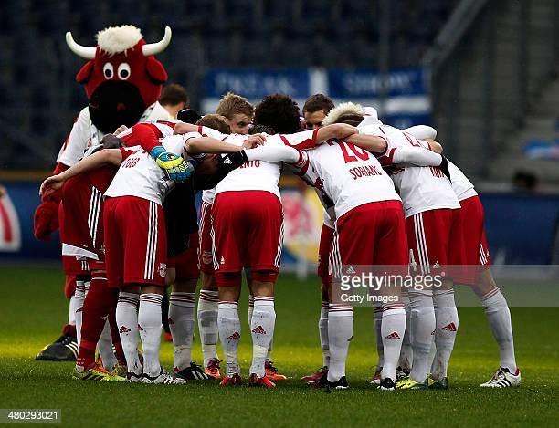 Players of Salzburg and their mascot stay together before the tipp3 Bundesliga match between Red Bull Salzburg and SC Wiener Neustadt at Red Bull...