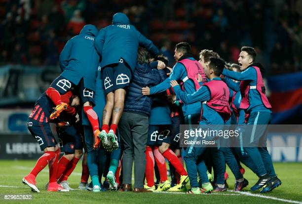 Players of San Lorenzo celebrate after winning the second leg match between San Lorenzo and Emelec as part of round of 16 of Copa CONMEBOL...