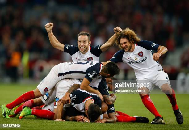 Players of San Lorenzo celebrate their thirth goal during the match between Atletico PR of Brazil and San lorenzo of Argentina for the Copa...