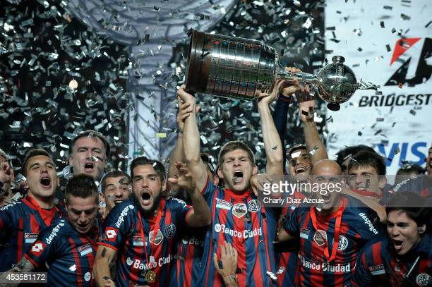 Players of San Lorenzo celebrate winning the Copa Libertadores after the second leg final match between San Lorenzo and Nacional as part of Copa...