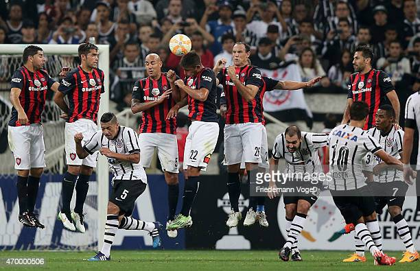 Players of San Lorenzo jump in the wall during a free kick of Jadson of Corinthians during a match between Corinthians and San Lorenzo as part of...