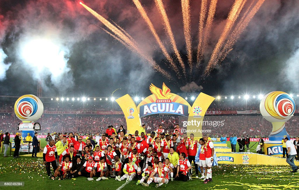Players of Santa Fe celebrate with the trophy after a second leg final match between Santa Fe and Deportes Tolima as part of Liga Aguila II 2016 at El Campin Stadium on December 18, 2016 in Bogota, Colombia.