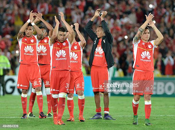 Players of Santa Fe greet their fans after qualifying to the next round after a second leg Quarter Final match between Independiente Santa Fe and...