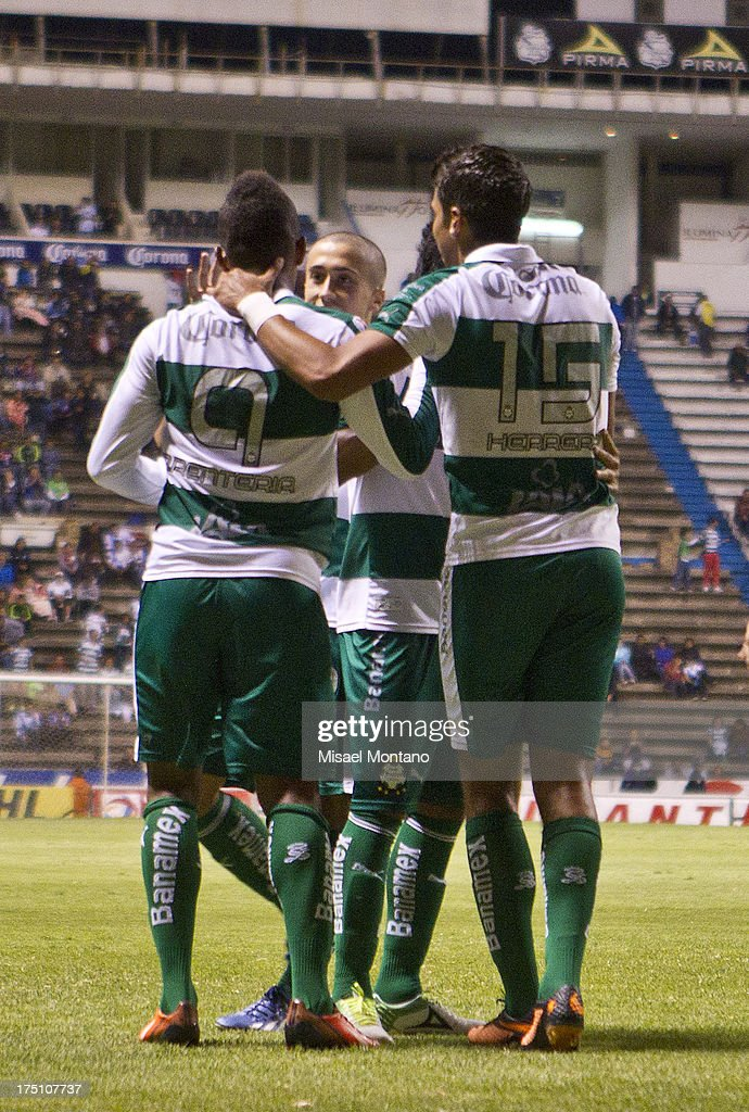 Players of Santos celebrate after scoring during a match between Puebla and Santos as part of the Torneo de Apertura 2013 Liga MX Championship at Cuauhtemoc Stadium, on July 31, 2013 in Puebla, Mexico.