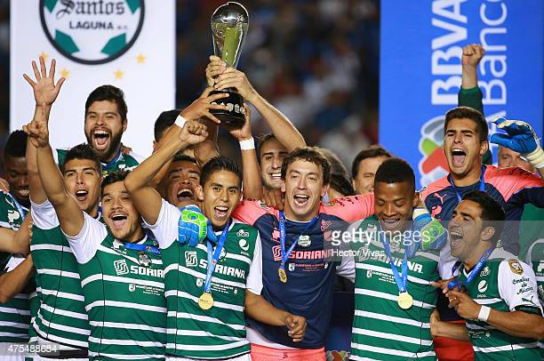 Players of Santos celebrate the championship after a championship second leg match between Queretaro and Santos Laguna as part of Clausura 2015 Liga...