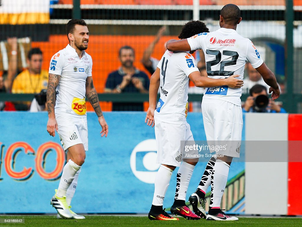 Players of Santos celebrate their second goal during the match between Santos and Sao Paulo for the Brazilian Series A 2016 at Pacaembu stadium on June 26, 2016 in Sao Paulo, Brazil.