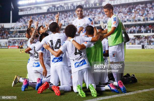 Players of Santos celebrate their secoond goal during the match between Santos of Brazil and The Strongest of Bolivia for the Copa Bridgestone...