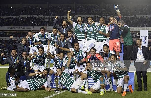 Players of Santos celebrate their victory over Queretaro following their finals match of the Mexican Clasura 2015 tournament in Queretaro Mexico on...