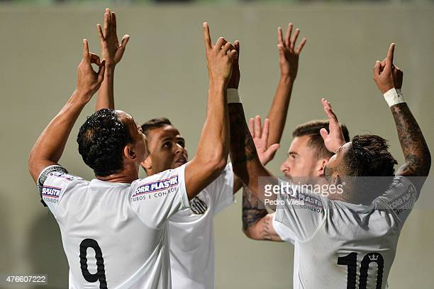 Players of Santos celebrates a scored goal against Atletico MG during a match between Atletico MG and Santos as part of Brasileirao Series A 2015 at...