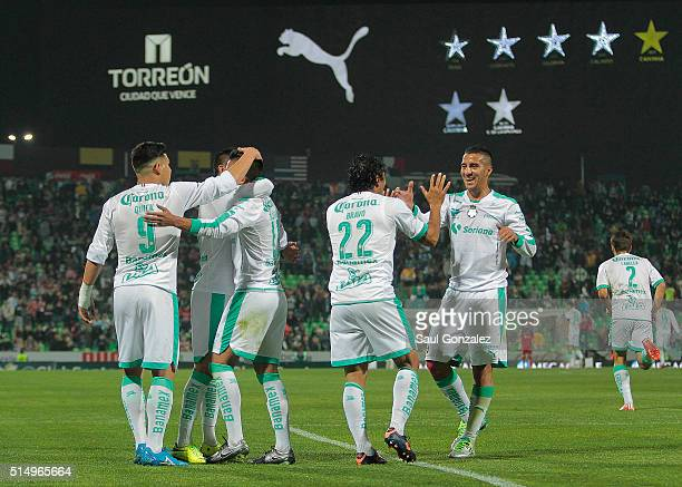 Players of Santos Laguna celebrate their team's first goal of his team during the 10th round match between Santos Laguna and Pachuca as part of the...