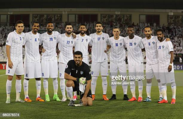 Players of Saudi club alHilal pose for a picture before their at AFC Champions League match between Qatar's alRayyan and Saudi Arabia's alHilal at...