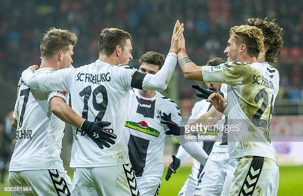 Players of SC Freiburg celebrate the second goal during the Bundesliga match between FC Ingolstadt 04 and SC Freiburg at Audi Sportpark on December...