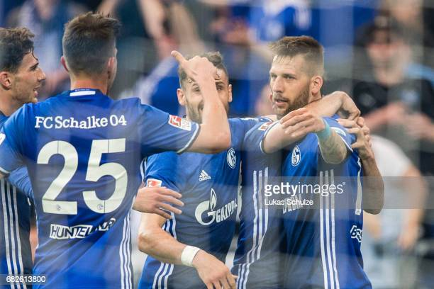Players of Schalke celebrate their teams first goal scoring by Guido Burgstaller during the Bundesliga match between FC Schalke 04 and Hamburger SV...