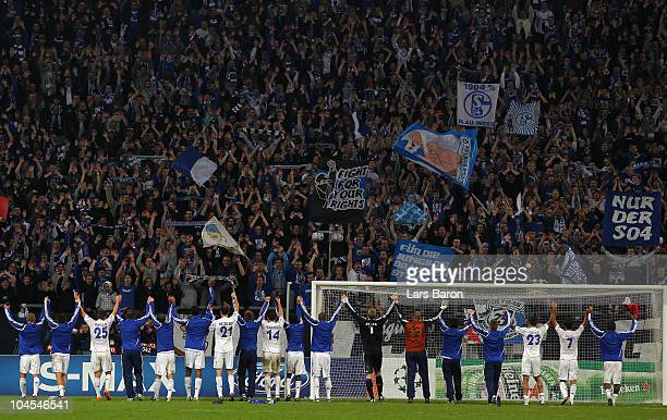 Players of Schalke celebrate with their fans after winning the UEFA Champions League match between FC Schalke 04 and SL Benfica at Veltins Arena on...