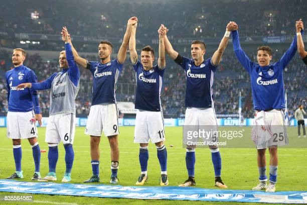 Players of Schalke celebrate with their fans following their victory during the Bundesliga match between FC Schalke 04 and RB Leipzig at VeltinsArena...